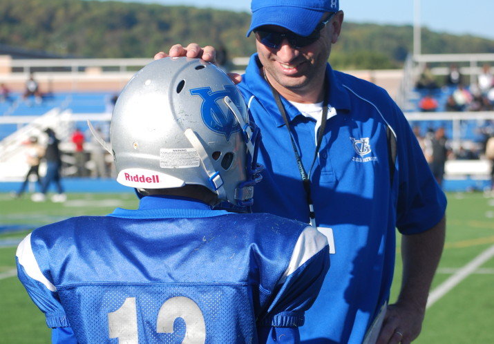 A volunteer GVFL coach encouraging a player on the sidelines