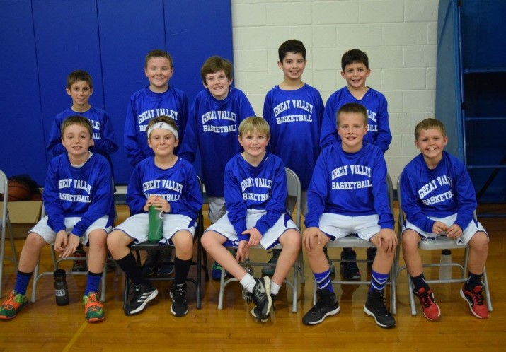 Some players from the fourth grade boys tournament team posing for a team photo