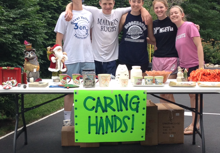 Student volunteers from our Caring Hands Group selling items to raise funds